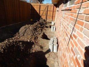 Backyard with Dug Hole for Foundation Installation
